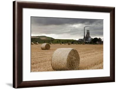 A Cement Production Plant with Hay Bales in a Field in the Foreground; Lothian Scotland-Design Pics Inc-Framed Photographic Print