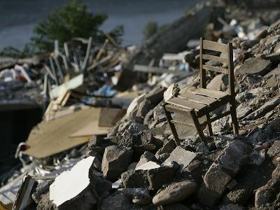 A Chair is Seen on the Rubble of a Collapsed Apartment Complex--Photographic Print