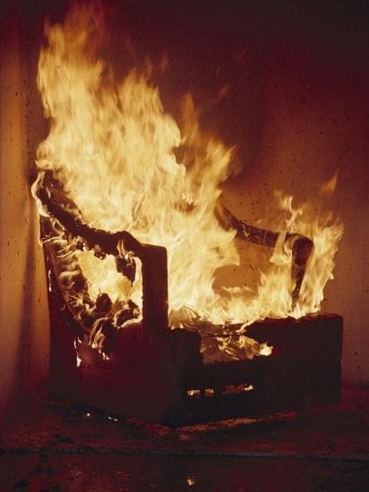 A Chair Set on Fire During a Flamability Test-Richard Nowitz-Photographic Print