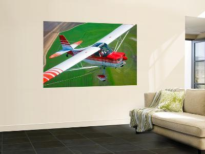 A Champion Aircraft Citabria in Flight-Stocktrek Images-Wall Mural