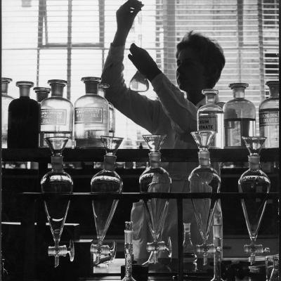 A Chemist at Work in Her Laboratory-Henry Grant-Photographic Print