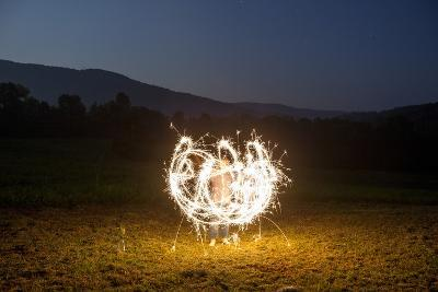 A Child Plays with Sparklers in a  Field in Lost Cove, Tennessee-Stephen Alvarez-Photographic Print