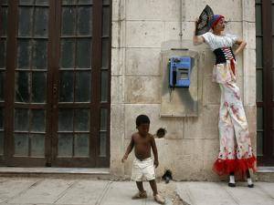 A Child Walks Past a Dancer of Giganteria's Group