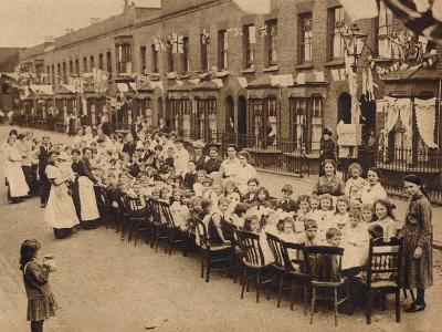 A childrens tea party in an East End Street in London, to celebrate the Treaty of Versailles at t--Photographic Print