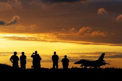 A Chilean Air Force F-16 Aircraft Landing at Sunset-Stocktrek Images-Photographic Print