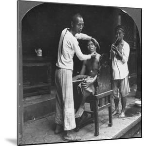 A Chinese Barber at Bhamo, Burma, 1908