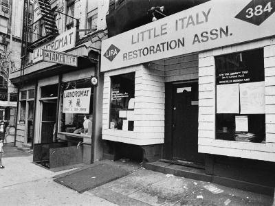 A Chinese Laundromat is Seen Next Door to the Offices of the Little Italy Restoration Association--Photographic Print