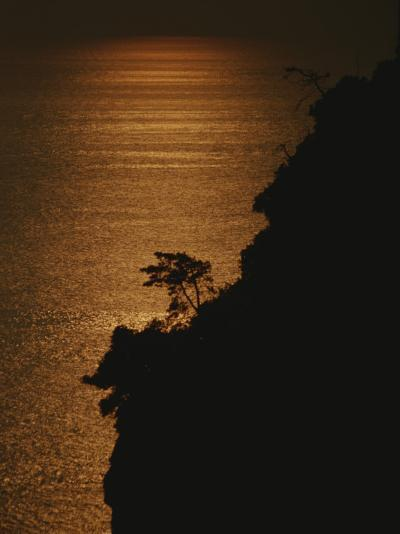A Cinque Terre Cliffside Silhouetted against the Sun-Reflected Sea-Raul Touzon-Photographic Print