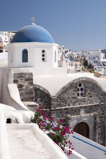 A Classic Blue Dome of a Greek Orthodox Church in the Picturesque Town of Oia, Santorini-Krista Rossow-Photographic Print