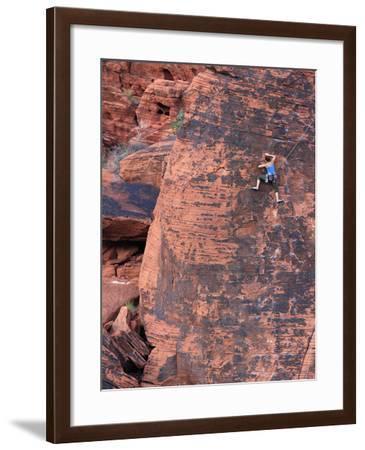 A Climber Ascends a Rock Face--Framed Photographic Print