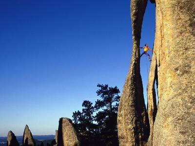 A Climber Leads a Route at the Needles in South Dakota-Bill Hatcher-Photographic Print
