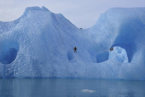 A Climber Navigates Tricky Terrain on a Blue Iceberg Off the Coast of Greenland-Keith Ladzinski-Photographic Print