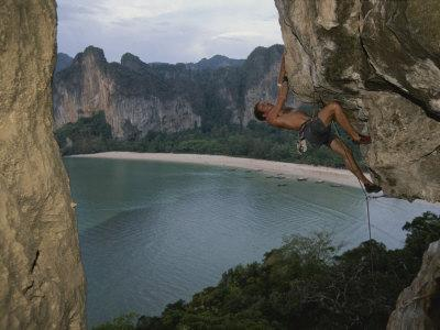 https://imgc.artprintimages.com/img/print/a-climber-negotiates-an-overhang-on-railay-beach_u-l-p4uuv00.jpg?p=0