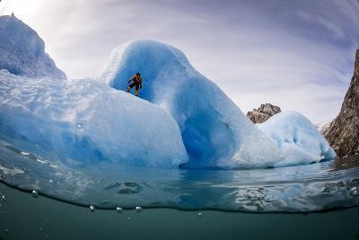 A Climber Prepares to Climb Blue Icebergs Off the Coast of Greenland-Keith Ladzinski-Photographic Print