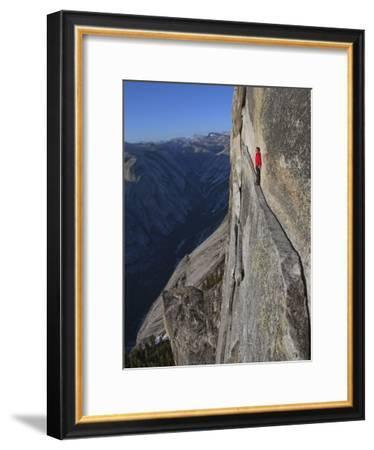 A climber walks a 40-foot-long sliver of granite on Half Dome, named the Thank God Ledge.-Jimmy Chin-Framed Photographic Print