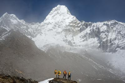 A Climbing Team Stand Looking Up at Ama Dablam in the Everest Region of Nepal-Alex Treadway-Photographic Print