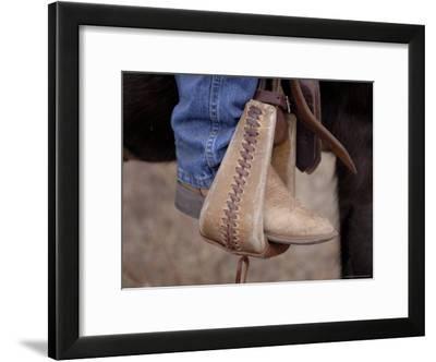 A Close-up of a Cowboy Boot in a Stirrup in the Nebraska Sandhills-Joel Sartore-Framed Photographic Print