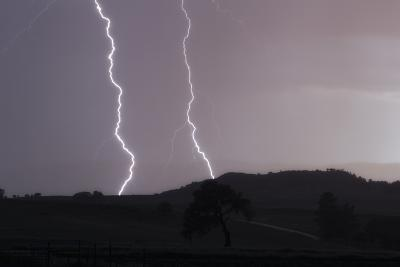 A Cloud-To-Ground Lightning Strike in a Mountainous Valley-Robbie George-Photographic Print