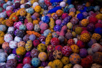 https://imgc.artprintimages.com/img/print/a-collection-of-brightly-colored-fabric-balls_u-l-pio2om0.jpg?p=0
