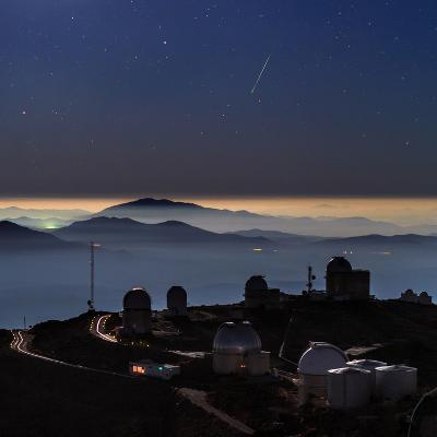 A Colorful Meteor Photographed Above Telescope Domes and Inversion Layer-Babak Tafreshi-Photographic Print