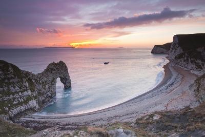 A Colourful Sunset over Durdle Door-Julian Elliott-Photographic Print