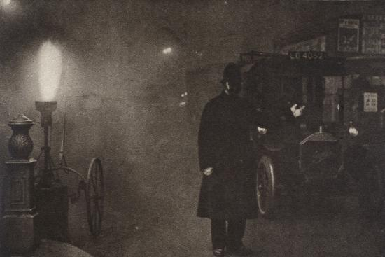 A constable directing traffic in the fog, London, c1910s-c1920s(?)-Unknown-Photographic Print