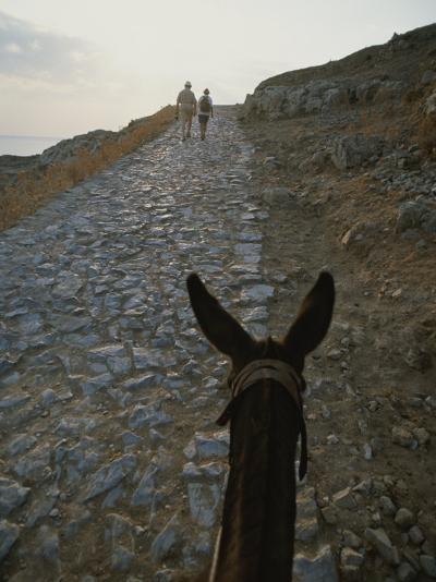 A Couple and a Donkey Walk up the Cobblestone Road to the Acropolis-Tino Soriano-Photographic Print