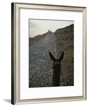 A Couple and a Donkey Walk up the Cobblestone Road to the Acropolis-Tino Soriano-Framed Photographic Print