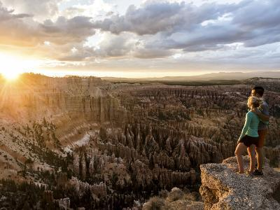 A Couple at Sunset in Bryce Canyon National Park, Utah, in the Summer Overlooking the Canyon-Brandon Flint-Photographic Print