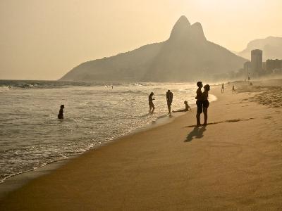 A Couple Embrace on Ipanema Beach as the Sun Sets-Kike Calvo-Photographic Print