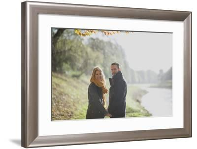 A Couple Holding Hands-Clive Nolan-Framed Photographic Print