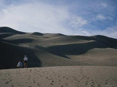 A Couple Look at the Dunes in Great Sand Dunes National Monument-Taylor S^ Kennedy-Photographic Print