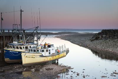 A Couple of Fishing Boats on Dry Land at Low Tide-Robbie George-Photographic Print