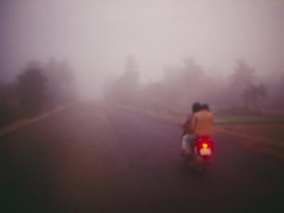 A Couple on a Motorcycle Head into Town Early in the Morning--Photographic Print