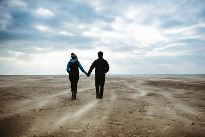 A Couple Together on a Winters Day on a Beach-Clive Nolan-Photographic Print