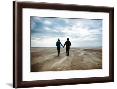 A Couple Together on a Winters Day on a Beach-Clive Nolan-Framed Photographic Print
