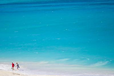 A Couple Walking the Beach Along Tropical Turquoise Waters-Mike Theiss-Photographic Print