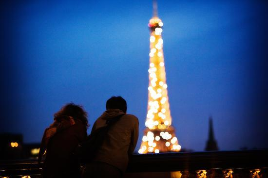 A Couple Watch the Eiffel Toer Glitter at Night in Paris, France-Chris Bickford-Photographic Print