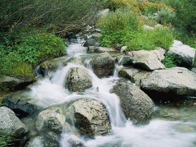 A Creek Flows over Granite Rocks in the Sierra Nevada Mountains-Marc Moritsch-Photographic Print