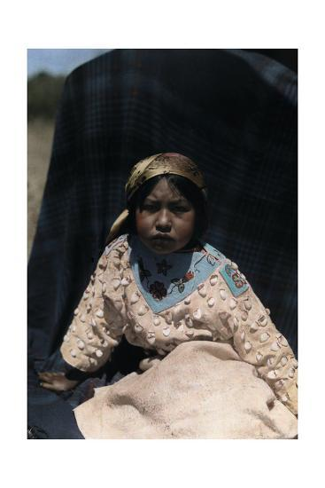 A Crow Indian Child Wears a Buckskin Dress of Beads and Teeth-Edwin L^ Wisherd-Photographic Print