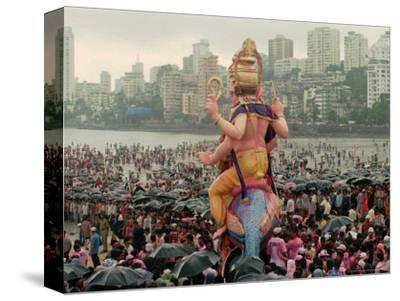 A Crowd of Revellers Carry a Statue of Ganesh