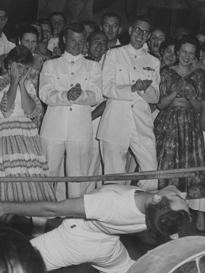 A Crowd Watches a Sailor Do the Limbo--Photographic Print