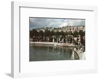 A Crowd Watches Little Boys Have Small Boat Races in a Pond-W. Robert Moore-Framed Photographic Print