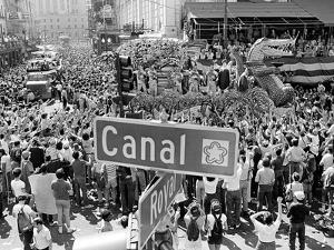 A Crowed Gathers as Floats Make Their Way Through Canal Street During the Mardi Gras Celebration