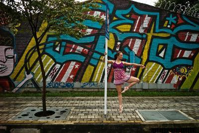 A Dancer Performs A Ballet Pose Outdoors Next To A Urban Grafitti-Kike Calvo-Photographic Print