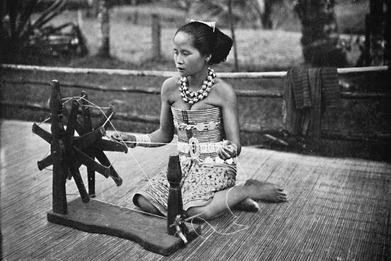 A Dayak girl at her spinning wheel, 1902-Unknown-Photographic Print