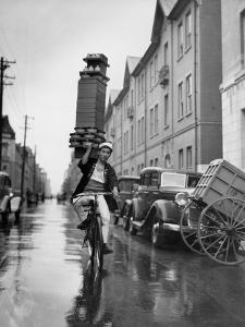 A Delivery Boy for a Tokyo Restaurant Carries a Tray of Soba Bowls