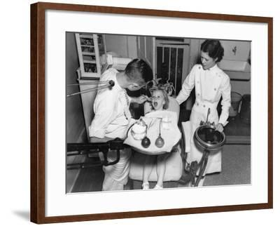 A Dentist Examining a Young Girl's Teeth in 1942--Framed Photo