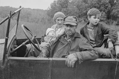 A Destitute Family with Their Old Car in Ozark Mountains During the Great Depression. Oct, 1935--Photo