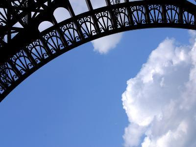 A Detailed Arch on the Eiffel Tower Against Blue Sky and Clouds--Photographic Print
